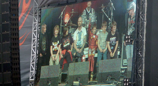 Ivan Moody of 5FDP on stage at Download Festival 2013 with a bunch of kids