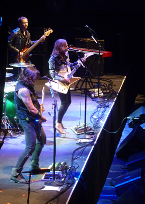 Halestorm on stage at Wembley Arena October 2013