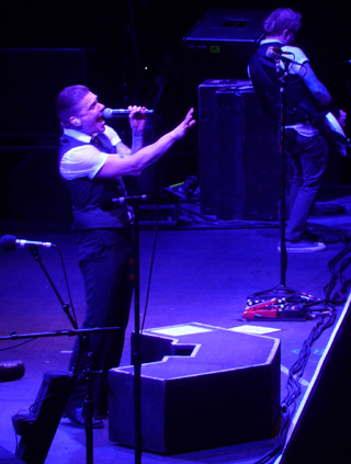 Shinedown's Brent Smith on stage at Wembley Arena October 2013